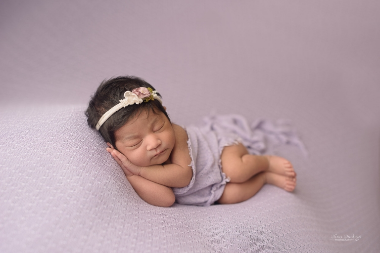 Newborn Baby Sleeping Sideways With Flower Head Band