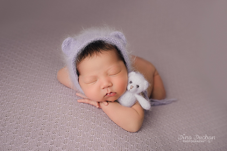 Brooklyn Newborn Photography baby with bear in bear bonnet